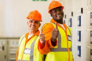 Construction company owners selling their business giving a thumbs up